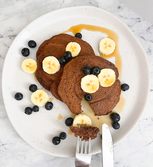 chocolate pancakes with blueberries and bananas